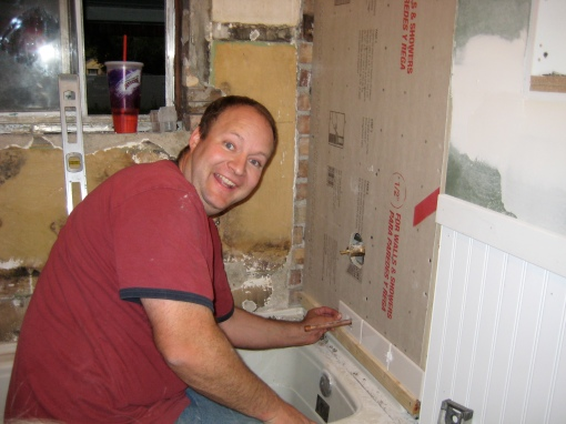 Matt shows me how to do wall tile