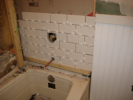 """Just tile up far enough so they can put the fixtures on, so you can at least take a bath for now."" -good advice from Matt"